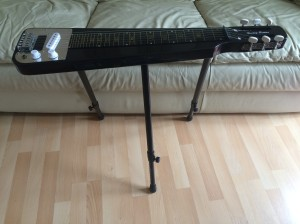 Photo of lap-steel guitar on stand