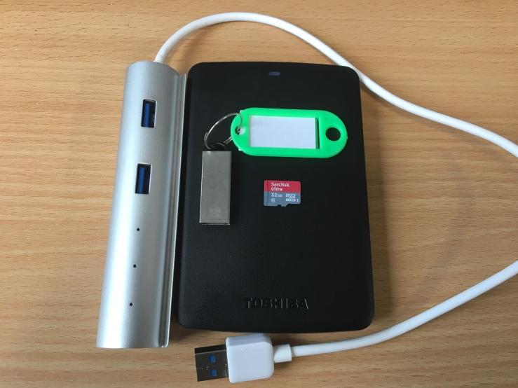 Photo of USB hub, hard drive, MicroSD card and USB flash drive