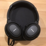 Photo of MPow H8 Bluetooth headphones on top of carrying case